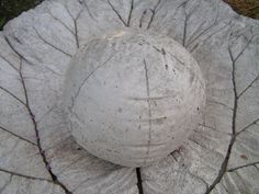 Beachballs and kid's rubber balls used as concrete molds - awesome!