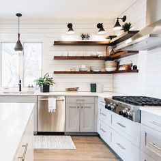 Medium tone Open Shelving with light wood floors in white kitchen