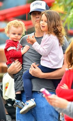 Superdad: Vince Vaughn was spotted carrying his four-year-old daughterLochlyn and son Vernon, aged 16 months, as they enjoyed a family trip to Disneyland in Anaheim, California on Saturday All In The Family, Family Day, Lindsay Vaughn, Vince Vaughn, Sweet Kisses, Four Year Old, Super Dad, Celebrity Kids