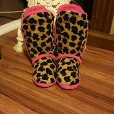 Leopard Print Boot Slippers Super cute leopard print boot slippers! Very comfy and warm! Nothing wrong with them just never wear them anymore so they need a new home! =-) Shoes Slippers