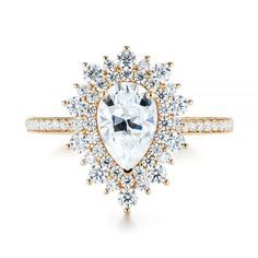 #103825 This dazzling engagement ring features a pear shaped diamond prong set in the center of a contoured double halo of shared prong set diamonds, accented by bright cut set... #DazzlingDiamondEngagementRings