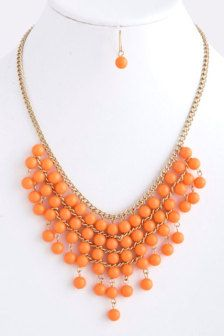 Originally $15, now only $9!    Coral Bib Necklace with Earrings - Anthropologie Inspired Statement Necklace    Chain length 16  Center drop 2.5  Lobster claw clasp with 3 extender  Comes with matching earrings
