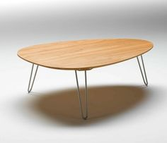 Coffee Tables  shape is mid-century modern -- might like to have that quirkiness -- unsure (also don't like the legs and lack of shelf)