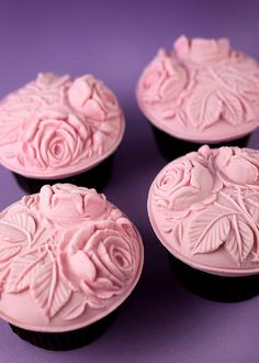 Fondant rolled onto cookie molds to create cupcake toppers...love!