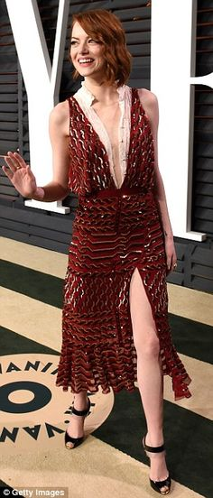 Sexy: Emma shined in both her celery green & burgundy gowns which featured a low back and a high side slit