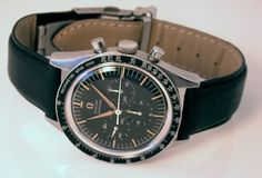 Omega Speedmaster with leather strap.