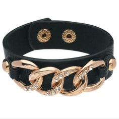 ❗️CLEARANCE❗️ Gold Chain Faux Leather Black Bracelet! By T&J Designs! Materials are faux leather, & base metals. Lead & nickel free. 2 snap adjustable closure. A fun way to add some sparkle and edge to any outfit! I have 4 of these available for sale. PLEASE DO NOT PURCHASE THIS LISTING! PLEASE ask me to create a new listing for you if you would like to purchase! T&J Designs Jewelry Bracelets