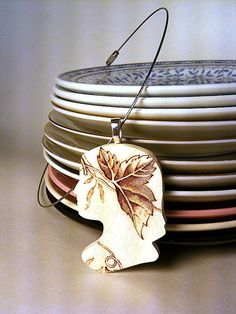 Necklace made out of a recycled plate. Made by Prettyville on etsy $25 # http://www.etsy.com/listing/76308698/florence-plate-wear-pendant-recycled