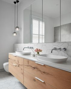 This bathroom is epitome of refined industrial elegance @smarterbathroomsplus mix neutral shades and exquisite natural surfaces with Caesarstone Fresh Concrete vanity tops And how about those fantastic hexagonal tiles #caesarstone