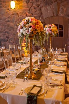 Designed by Bella Fiori, Colorado - Elevated centerpiece of blush and gold flowers on gold stand for a wedding