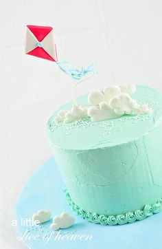 """A simple christening cake with a kite flying abovesugarpaste clouds. """"The christening was wonderful, exhausting but wonderful. Everyon..."""