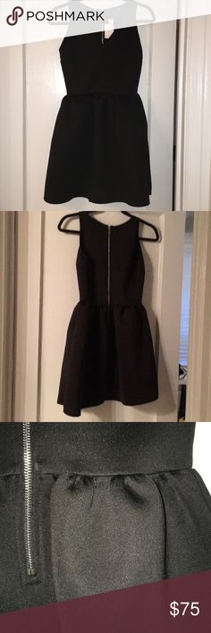Little Black Dress! LBD Perfect lbd!  Never worn, tags on.  Style that flatters everyone. Stretchy material that also holds it's shape as you can see by the skirt. Aqua Dresses