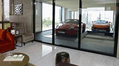 Singapore High Rise Offers Garages with a View...really? Your cars need a view...wow.
