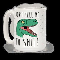 """This sassy feminist dinosaur mug reads, """"Don't Tell Me To Smile"""" an features an angry raptor ready to tear the head off of any misogynist getting in her way! Use this dino coffee mug to let everyone know that they better think twice before telling you to smile!"""