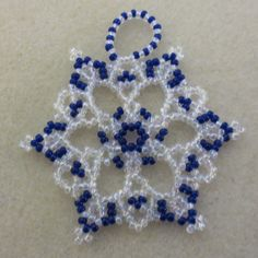 Bead and crystal snowflake / wreath by LescreationsAlepine on Etsy Beaded Christmas Decorations, Christmas Ornament Crafts, Christmas Jewelry, Christmas Trees, Xmas, Beaded Ornament Covers, Beaded Ornaments, Diy Ornaments, Glass Ornaments