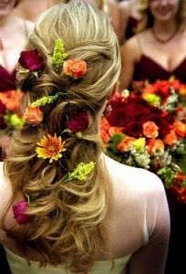 pulled back style with flowers woven into style