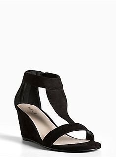 "<p>These mini wedges are the perfect dancing partner to whatever look you pair it with. Black faux suede is a go-with-anything kind of color, while the T-strap and peep toe upper are comfy-meets-sleek.</p><ul>	<li>2.5"" wedge</li>	<li>Man-made materials</li>	<li>Imported</li></ul>"