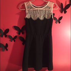 Black dress with white lace accent size medium Black Charlotte Russe dress with black lace size medium Charlotte Russe Dresses