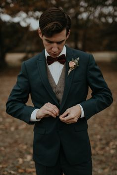 Forest green tux + velvety red bow tie   Image by B. Matthews Creative
