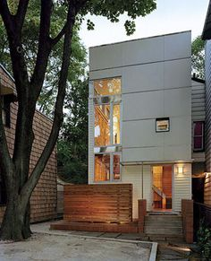 """""""Designed by architects Margarita McGrath and Scott Oliver in the Brooklyn borough of New York. When McGrath and Oliver transformed the existing row house in the fort Greene neighborhood of Brooklyn, they preserved a tall maple tree in the front yard, creating an outside room around it.""""   (AP Photo/Rizzoli, Chuck Choi)      Read more: http://www.timesunion.com/living/article/Living-small-becoming-a-big-trend-1040711.php#ixzz1u6iNhwDg"""