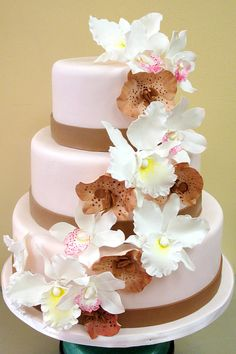 Lotsa orchids wedding cake; have wedding color instead of brown though