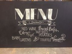 Menu chalk board that went into a rustic bar for a spring mountain wedding.