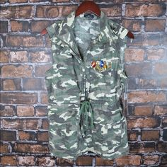 Jeweled accented camouflage vest jacket Brand: Ali& Kris Size: M  New  Camouflage sleeveless vest. Jewels accent the front plant pocket. Zipper closure with a drawstring for a more adjustable fit.  100% cotton/ camouflage Jackets & Coats Vests