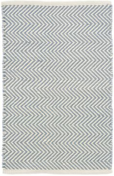 The zigzag pattern on this thick indoor/outdoor PET rug offers geometric interest on a durable, easy-care floor covering. Made of 100% PET, a polyester fiber made from recycled plastic bottles. - 100%