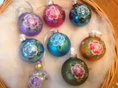 Rose, rosebuds, and circles of flower ornaments