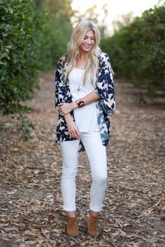 The best way to wear white pants in winter is by pairing them with a patterned kimono.