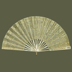 Queen Alexandra's Fabergé fan circa 1904.  Purchased by the Dowager Tsarina Marie Feodorovna for Queen Alexandra.  The fan is cream silk gauze leaf, mounted à l'anglaise; front guard of mother-of-pearl and three-colour gold enamelled in white over a guilloché ground, decorated with gold, silver, diamonds and cabochon Burmese rubies.