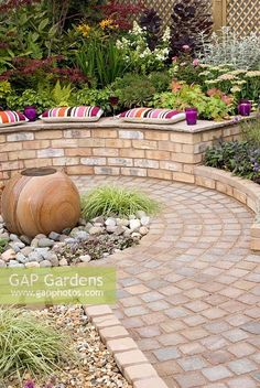 Circular cobble sett patio with central stone sphere water feature and brick walls with raised beds. Southport Flower Show 2010 shed landscaping shed landscaping landscaping flower beds landscaping gravel of shed landscaping Brick Wall Gardens, Brick Garden, Glass Garden, Raised Patio, Raised Garden Beds, Stone Raised Beds, Raised Flower Beds, Garden Features, Water Features