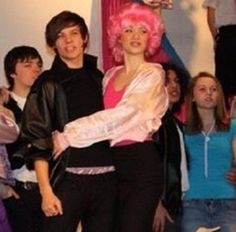 Louis Tomlinson performing in Grease