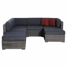"""A perfect anchor for your sunroom or veranda, this outdoor seating group showcases navy cushions and wicker-inspired designs.  Product: 2 Corner pieces 2 Middle pieces 2 Ottomans Construction Material: Aluminum, polyester and synthetic wickerColor: Grey and navyFeatures:  Cushions are includedSuitable for indoor and outdoor useDimensions: Corner Piece: 27"""" H x 32"""" W x 32"""" D Middle Piece: 27"""" H x 28"""" W x 32"""" D Ottoman: 13"""" H x 28"""" W x 28"""" D  Note: Accent pillows are not included"""