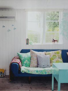 Blue couch with retro cushions