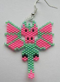 Beautiful Hand Beaded Neon Pink and Neon Green Dragon earrings.