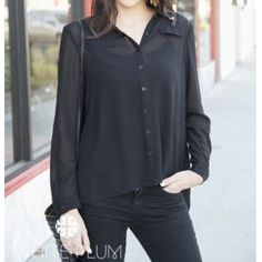 Black button down top See through black button down. Looks great with a black tank top underneath. High low style. Can roll sleeves up. Size large. Sorry for the bad picture of it modeled but just giving an idea of how you can wear it! Just needs a cami underneath! Tops Button Down Shirts