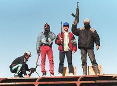 PUSHNJE, ALBANIA: Armed Albanian rebels stand on the top of a bus which was destroyed by fire during a riot at a roadblock near Pushnje 12 March 1997 as unrest in Albania inched closer to the capital Tirana. Albanian President Sali Bericha was trying to defuse tension by forming a new government headed by a Socialist opposition. Insurgents 12 March were still demanding that Berisha himself resign, while the opposition was expected to continue haggling over the appointment of cabinet…