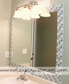How to Mosaic Tile a Mirror DIY. This would go so well in our upstairs guest bathroom where we have a huge, flat, ugly mirror on the wall.