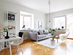 Small doesn't need to mean crowded. Keep all furnitures above the floor level and you'll be ok. Scandinavian apartment with herringbone parquet floors