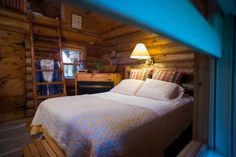 Little House on the Prairie log cabin. 250 square feet of cozy! Climb a ladder to a whirlpool complete with skylight & porthole. Watch the sunset, llamas or stars. We're pet-friendly and pets may stay with you. We also offer a 36 x 100 timber frame wedding barn. Our backyard is 200 organic acres with woodland, meadows and ponds. Read more www.justintrails.com - photo by Joe Leute & Carla Minsky