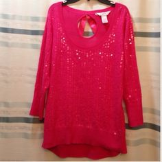 Candie's Sequin Top Adorable Candie's pink sequin light-sweater top with cute peephole and ribbon now accent on the back. 3/4 sleeve! High low hem. Brand new condition. Only worn one time!! Candie's Tops Blouses