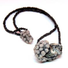 Linda Ezerman : shells, felt, glass beads, silk, silicone