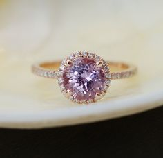 Rose gold engagement ring  How do I go to tell you about the beauty of this ring ? :)   The sapphire is unheated and untreated. The color is lavender. Amazing cut - tone of sparkles. It is 2.42ct, eye clean. The color is lavender, purple, mauve.  14k rose gold halo setting, TDW approx. 0.2ct. Size