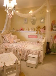 Love the chair rail to put stuff up on... and the netting over the bed.  I would so love to make this room for Anna at my house!