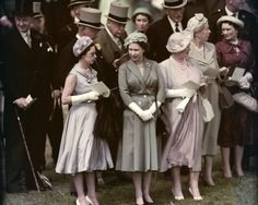 Princess Margaret, Queen Elizabeth II, and the Queen Mother visit the Epsom Downs Racecourse for the Derby.