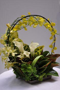 flower arragement, Magnolia leaf, Croton, Oncidium, D. phalaenopsis, Calla lily