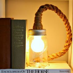 DIY Rope Mason Jar light [the first DIY that have have found that I can do all by my big self and looks amazing! Rustic chic anyone?