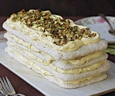 Pistachio-flecked meringue layers contrast a tangy, creamy lemon curd filling in this stunning dacquoise. Perfect for a special occasion, this make-ahead dessert needs at least 24 hours in the refrigerator before serving to soften a bit. Make Ahead Desserts, Just Desserts, Lemon Curd Filling, French Pastries, Pistachio, Cheesecakes, Cake Recipes, French Dessert Recipes, Sweet Tooth