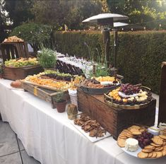 Tuscan wedding appetizer styling ideas. Use of vintage crates, wooden and marble cheeseboards, fresh potted lavender for more organic touches.
